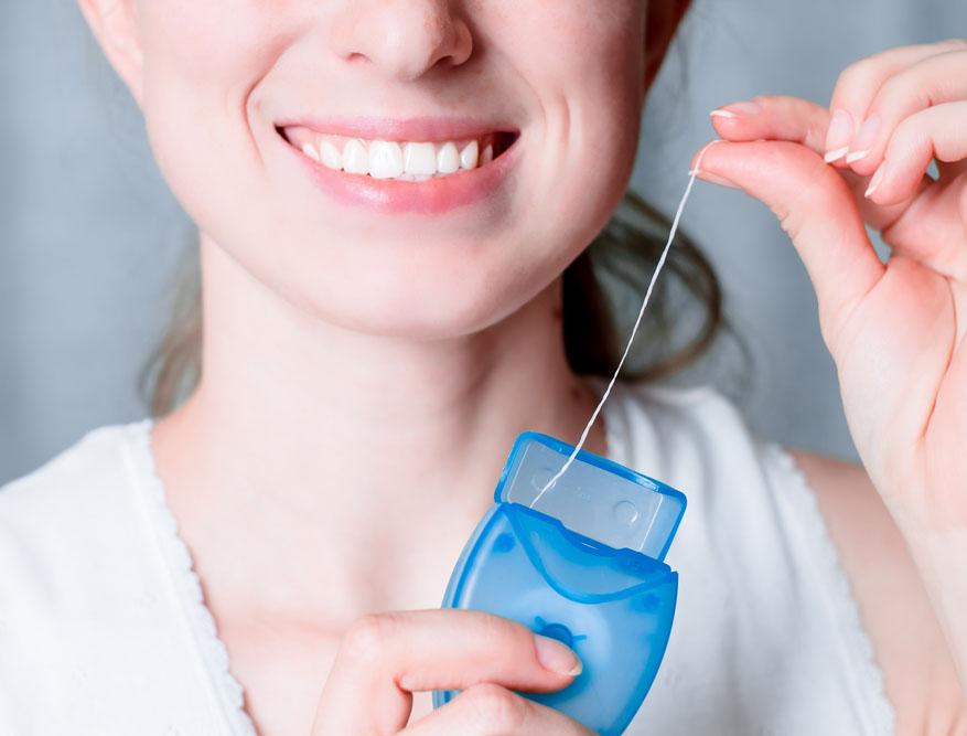 Использование зубных нитей